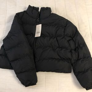 Black puffer jacket. New with tags